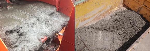 手作業でヘドロを吸い出す吸引スタッフたち。泥の固さを手探りで調整しながら吸引する